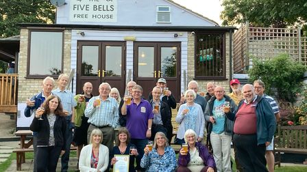 CAMRA members, Debbie Oliver (front row, second from left), staff and customers at the Five Bells