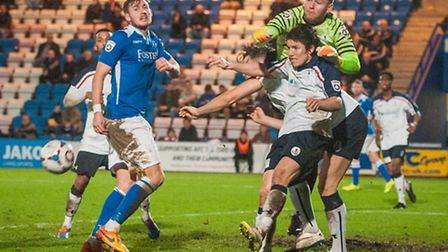 James Montgomery of A.F.C. Telford United punches clear a corner whilst Shaun Bammant of Lowestoft T