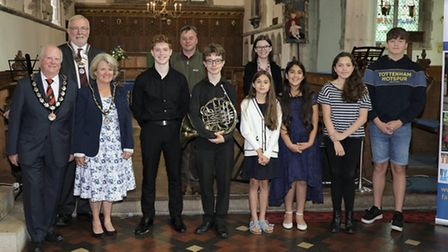 A group of people, including Great Dunmow mayor Cllr Patrick Lavelle and young musicians with their instruments