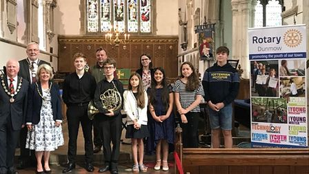 A group of people in St Mary's Church, Dunmow including Mayor of Dunmow Cllr Patrick Lavelle and young musicians