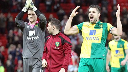 Norwich City captain Russell Martin leads the celebrations at Old Trafford. Picture by Paul Chestert
