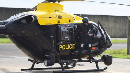 A police helicopter in its dark blue and yellow colours