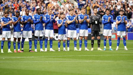 Town players in a minutes applause for the late Paul Mariner.