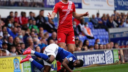 Kane Vincent-Young is fouled by Liam Gibson.
