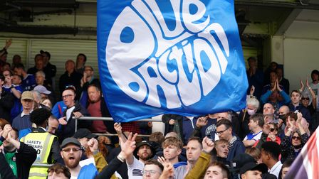 A Blue Action banner on display amongst Town fans.