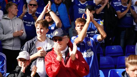 Town fans applaud at the final whistle.