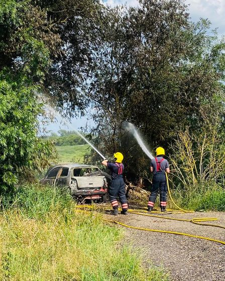"""Fire crews arrived in Isleham to find a car """"well alight with the fire spreading to nearby trees"""