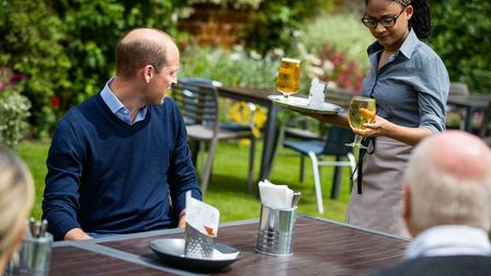 The Duke of Cambridge talks to the landlords and workers at The Rose and Crown pub in Snettisham.