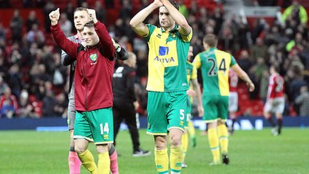 Russell Martin of Norwich, Wes Hoolahan of Norwich and Declan Rudd of Norwich celebrate victory at t