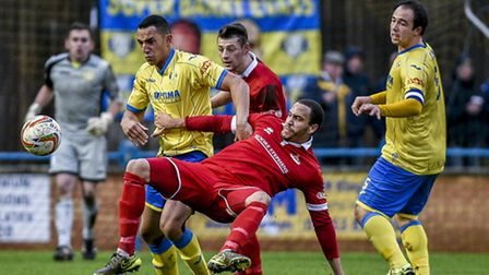 Action from King's Lynn Town v Frome Town at The Walks - Lynn's Kern Miller challenges for the ball,