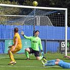 Barking's Charlie Heatley hits the crossbar at Brentwood Town