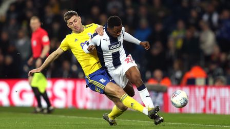 Birmingham City's Gary Gardner (left) and West Bromwich Albion's Kyle Edwards battle for the ball du