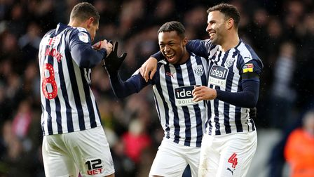 West Bromwich Albion's Kyle Edwards (centre) receives the captain's armband from Jake Livermore afte