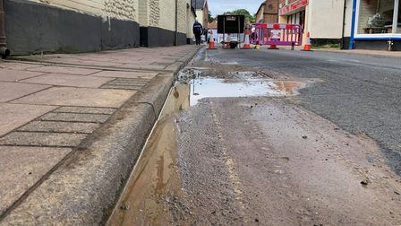 Miss Buck said water has been running up alongside the road on Oak Streetfor the past two weeks.