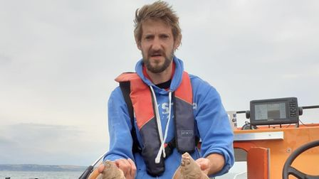 Daniel Patrick with a brace of Plaice caught from his own boat
