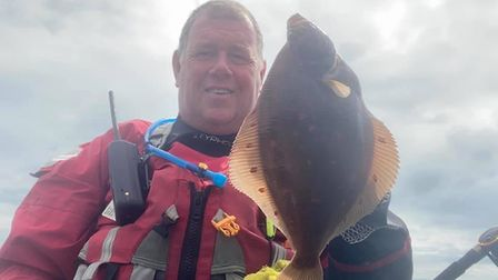 Marcus Ward with a Plaice caught from his Kayak