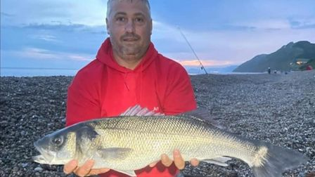 Arron Griffiths with an 8lbs Bass caught at Branscombe