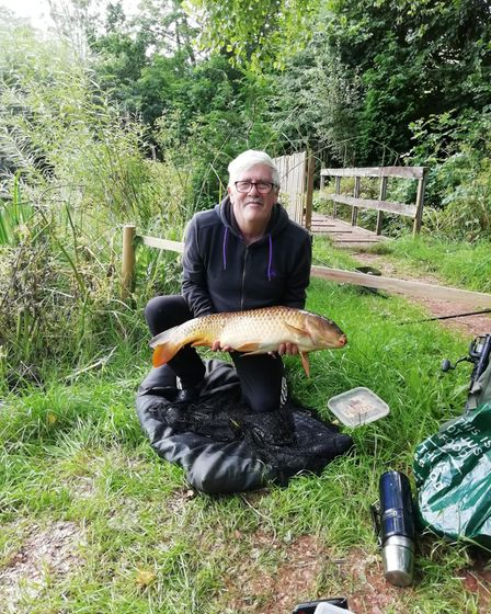 Steve Brettle with a 19lbs Common Carp from Newbarn Angling Centre