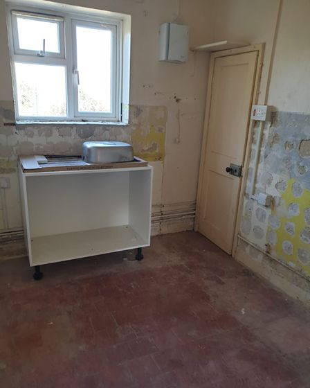 A 'before' shot of the kitchen inside one of the houses in Northfield Waye, Wells,