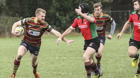 Action from Norwich's (stripes) defeat to Fullerians in the Intermediate Cup at Beeston Hyrne - Mich