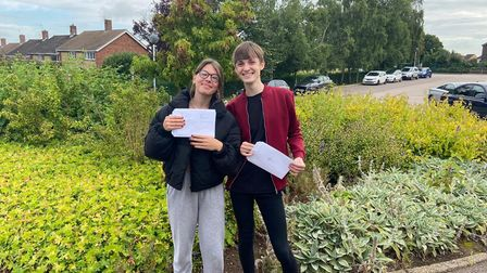 Emma Iested and Jacob Burdenwith their results at Bungay High School.