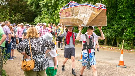 Lads carrying their cardboard raft to the water at a previous riverside community day.