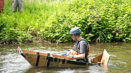 One cardboard raft gracing the water at a previous riverside community day.