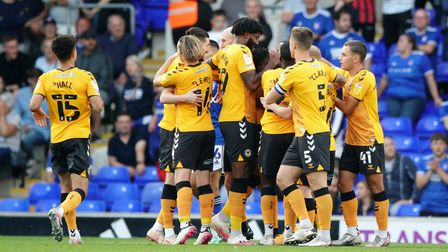 Newport County celebrate their early goal.
