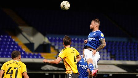James Norwood heads over the bar.