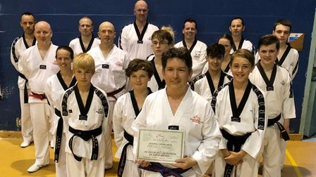 Ely taekwondo students with grading certificate