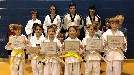 Ely taekwondo students with their grading certificates