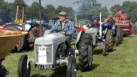 Tractors make their way to the grand ring at Henham Steam Rally in 2005