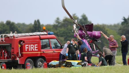 Fire and rescue service crew at the scene of a gyrocopter crash