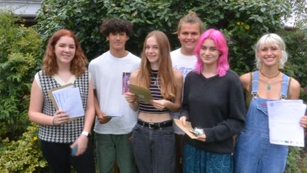 Thomas Mills High School pupils pose with their grade sheets