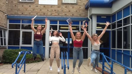 Hobart High School students jumping in the air.