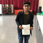 Robert Clack School pupil Muneeb Musharaf with his GCSE results