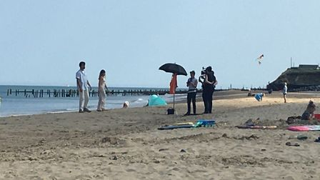 The crew on the beach at Happisburgh. The crew have been filming there and around the coast at