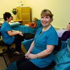 Owner Sharon Tomasso in one of the treatment rooms at the newly opened Acle Physical Therapy clininc