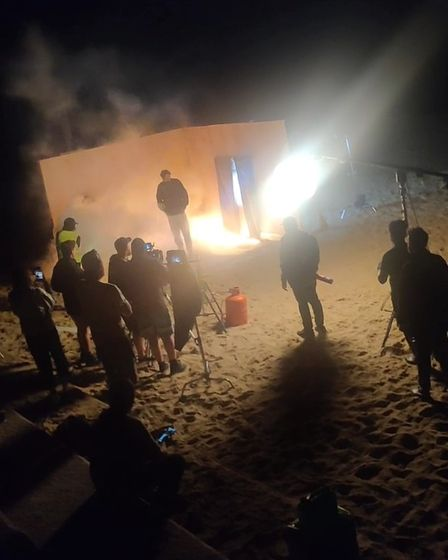 A fire was lit as part of the filming at Cart Gap beach.