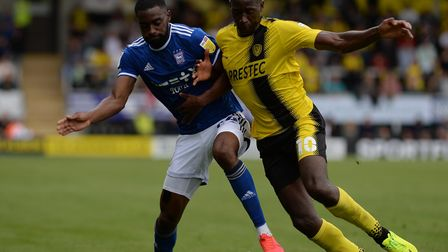 Kane Vincent-Young is kept at bay by Lucas Akins at Burton Albion.