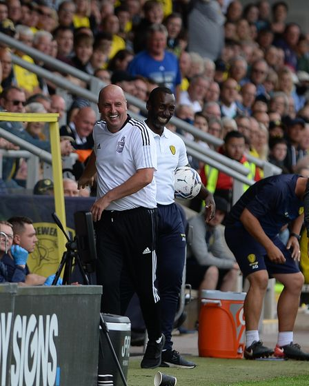 The two managers are all smiles again after a little altercation on the touchline which resulted in