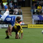 Lee Evans is cleaned out by a challenge from Michael Mancienne at The Pirelli Stadium.