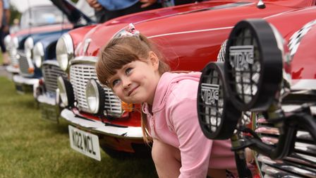 Eight-year-old Holly Pearson enjoying the minis at the classic car show at Stonham Barns. Picture: D