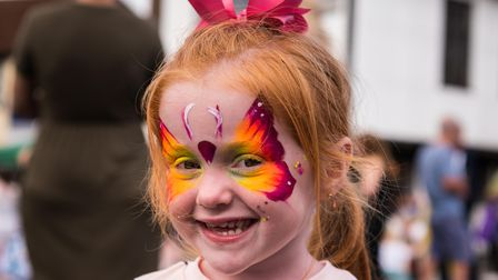 A girl with a face painted as a butterfly, Great Dunmow Summer Market, Essex