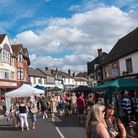A street scene showing the crowd at Great Dunmow Summer Market, Essex