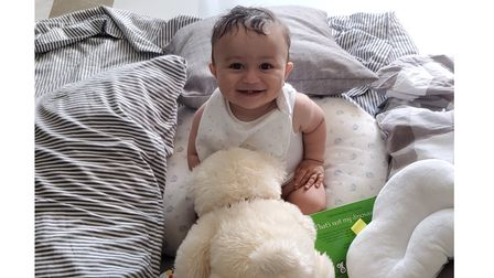 Happy baby Jibreel at playtime with his favourite toy