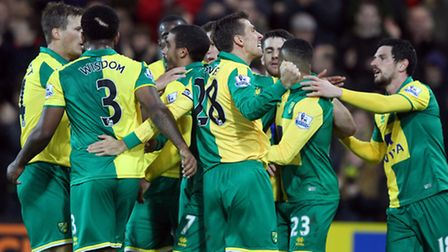 Norwich City players celebrate Lewis Grabban's equaliser against Arsenal. Picture by Paul Chesterton
