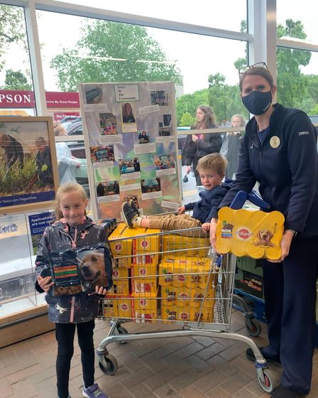 Jessica and Oliver Skilton buying a trolley full of dog food from Tesco in Bury St Edmunds