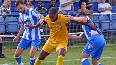 The Hullbridge defenders get to grips with Barking's James Folkes