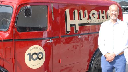 photo of Robert Hughes and the special van recreated to celebrate Hughes Electricals' 100 years in business.
